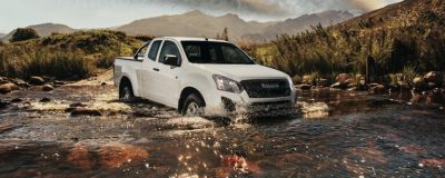 Isuzu kb extended cab driving through a river